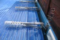 Фото: Опорные направляющие консоли с роликами для жалюзи